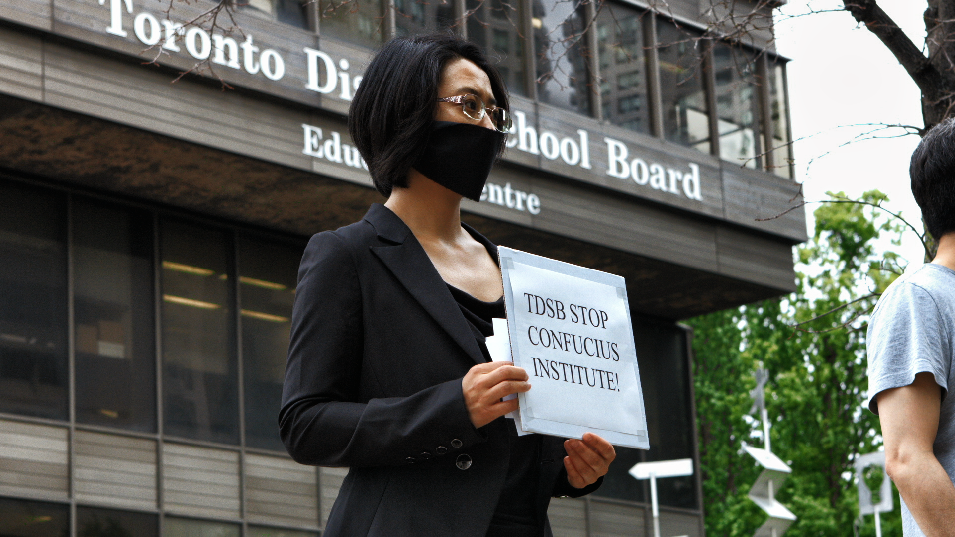Sonia Zhao protests the CI at the TDSB.